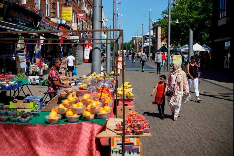 Up and coming: Walthamstow's lively high street has had a makeover (AFP via Getty Images)