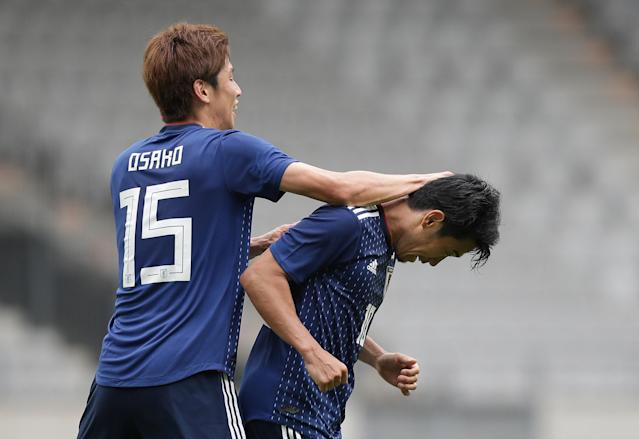 Soccer Football - International Friendly - Japan vs Paraguay - Tivoli-Neu, Innsbruck, Austria - June 12, 2018 Japan's Shinji Kagawa celebrates scoring their fourth goal with Yuya Osako REUTERS/Lisi Niesner
