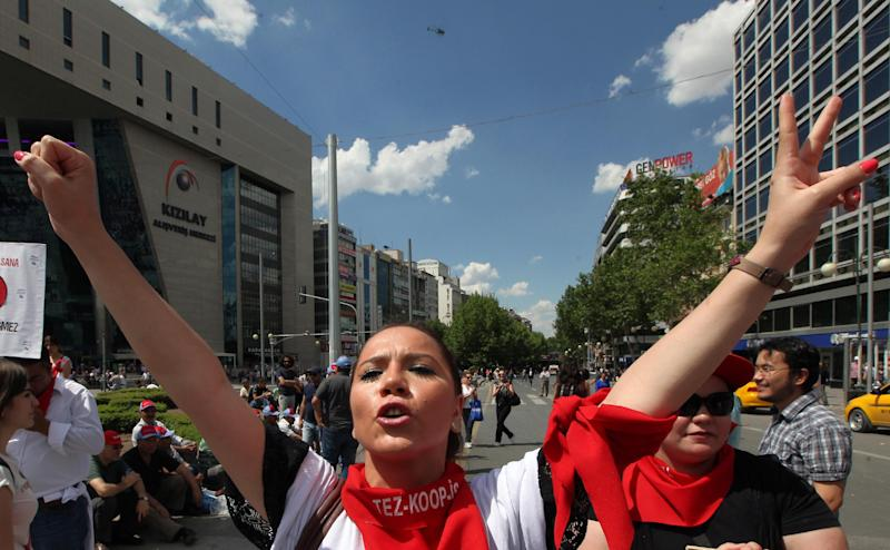 """REMOVES INCORRECT TRANSLATION - A Turkish protester shouts slogans such as """"Don't yield"""" as thousands of trade union members who are on a two-day strike march to Kizilay Square, in Ankara, Turkey, Wednesday, June 5, 2013. A group of activists have met with Turkey's deputy prime minister to present demands that could end days of anti-government demonstrations if met. The group urged the government to end plans to develop a park in Istanbul, stop tear gassing protesters, and lift restrictions on freedom of expression and assembly. (AP Photo/Burhan Ozbilici)"""