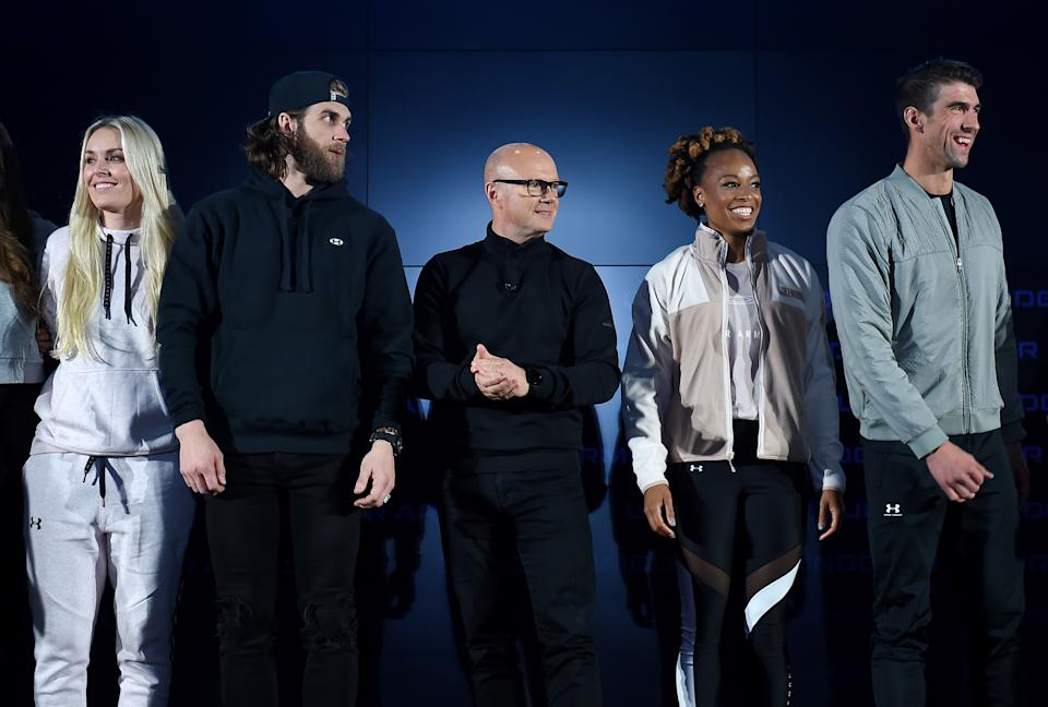 (L-R) US ski champion Lindsey Vonn, Phillies baseball player Bryce Harper, CEO Of Under Armour Patrik Frisk, champion sprinter Natasha Hastings and former record-winning US Olympian swimmer Michael Phelps stand on stage at the 2020 Under Armour Human Performance Summit on January 14, 2020 in Baltimore, Maryland. (Photo by OLIVIER DOULIERY / AFP) (Photo by OLIVIER DOULIERY/AFP via Getty Images)