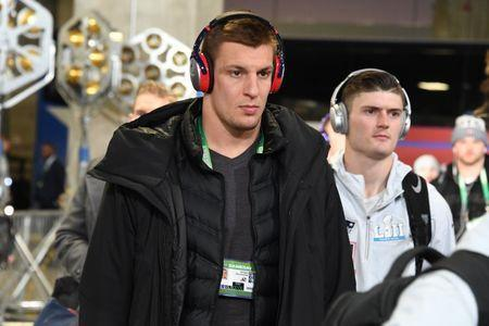 Feb 4, 2018; Minneapolis, MN, USA; New England Patriots tight end Rob Gronkowski (middle) arrives at U.S. Bank Stadium before Super Bowl LII against the Philadelphia Eagles. Mandatory Credit: Kirby Lee-USA TODAY Sports