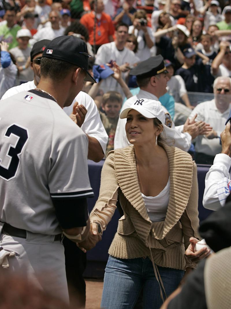 8bbb20398d0bb9 Actress Jennifer Lopez shakes hans with Alex Rodriguez before a subway  series game between the New