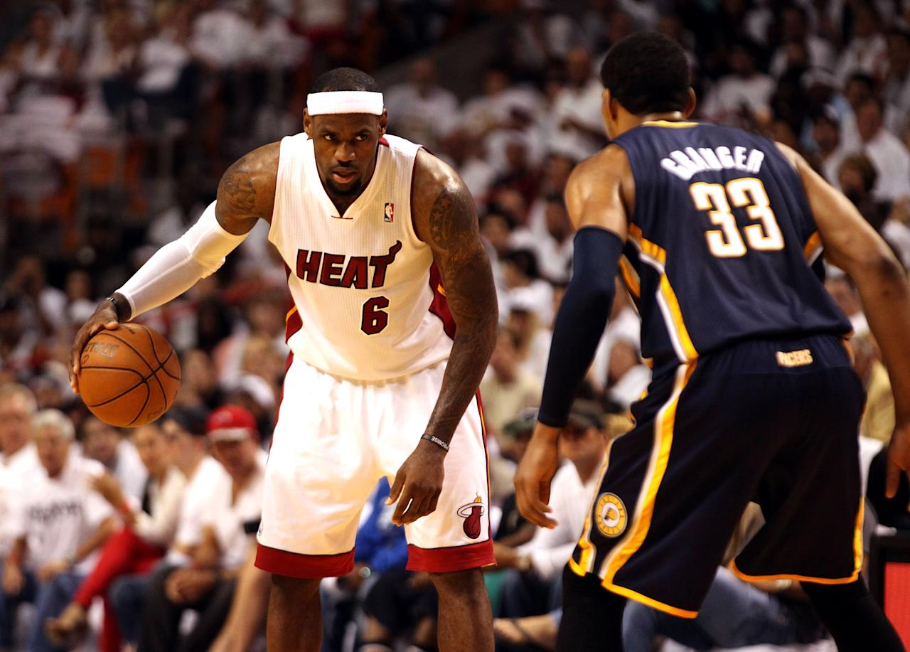 MIAMI, FL - MAY 13:  Forward Lebron James #6 of the Miami Heat drives against Forward danny Granger #33 of the Indiana Pacers in Game One of the Eastern Conference Semifinals in the 2012 NBA Playoffs on May 13, 2012 at the American Airines Arena in Miami, Florida. NOTE TO USER: User expressly acknowledges and agrees that, by downloading and or using this photograph, User is consenting to the terms and conditions of the Getty Images License Agreement.  (Photo by Marc Serota/Getty Images)