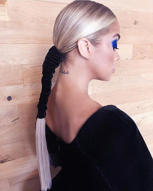 """<p>Why stop at just a hair tie? <strong>Wrap your pony with an expensive-looking material </strong>(Justine Marjan used a <a href=""""https://www.amazon.com/VATIN-Crushed-Ribbons-Perfect-Choker/dp/B079K8S2J6"""" rel=""""nofollow noopener"""" target=""""_blank"""" data-ylk=""""slk:strip of velvet"""" class=""""link rapid-noclick-resp"""">strip of velvet</a> here) halfway down the tail to really make an impact.</p><p><a href=""""https://www.instagram.com/p/BjoL47RBN8Y/"""" rel=""""nofollow noopener"""" target=""""_blank"""" data-ylk=""""slk:See the original post on Instagram"""" class=""""link rapid-noclick-resp"""">See the original post on Instagram</a></p>"""