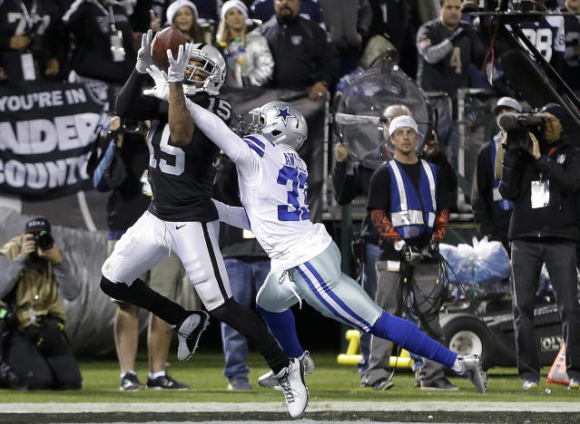 FILE - In this Dec. 17, 2017, file photo, Oakland Raiders wide receiver Michael Crabtree (15) catches a touchdown pass in front of Dallas Cowboys cornerback Chidobe Awuzie (33) during the second half of an NFL football game in Oakland, Calif. The Raiders are shuffling wide receivers, signing free agent Jordy Nelson and releasing Crabtree. A person familiar with the moves says Nelson has agreed to a two-year contract on Thursday, March 15, 2018, after spending more than a day meeting with the former Green Bay Packers star. (AP Photo/Ben Margot, File)