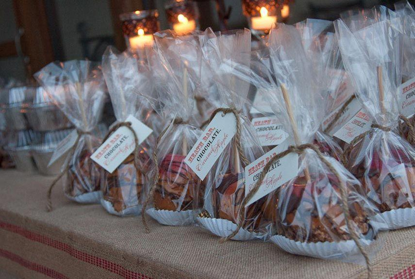 """<p>If you plan on giving out a party favor, choosing something cheap, but useful or consumable. Our go-to gift for autumn? Caramel apples. </p><p><strong><a href=""""https://www.countryliving.com/food-drinks/recipes/a1974/caramel-apples-clv0907/"""" rel=""""nofollow noopener"""" target=""""_blank"""" data-ylk=""""slk:Get the recipe"""" class=""""link rapid-noclick-resp"""">Get the recipe</a>.</strong></p>"""