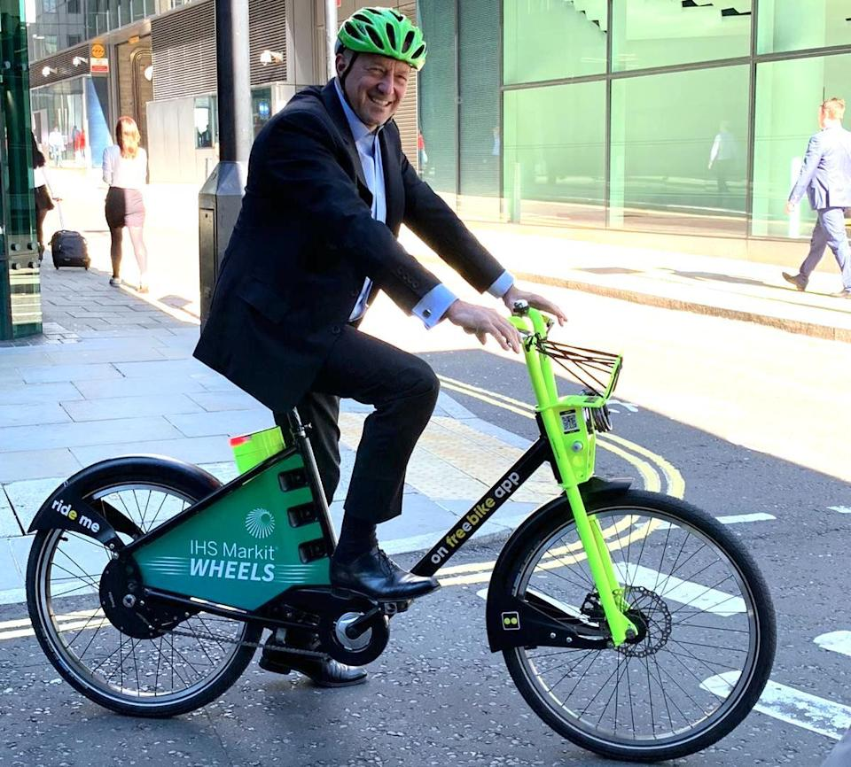 Happy customer: IHS Markit CEO Lance Uggla on one of the new electric bikes
