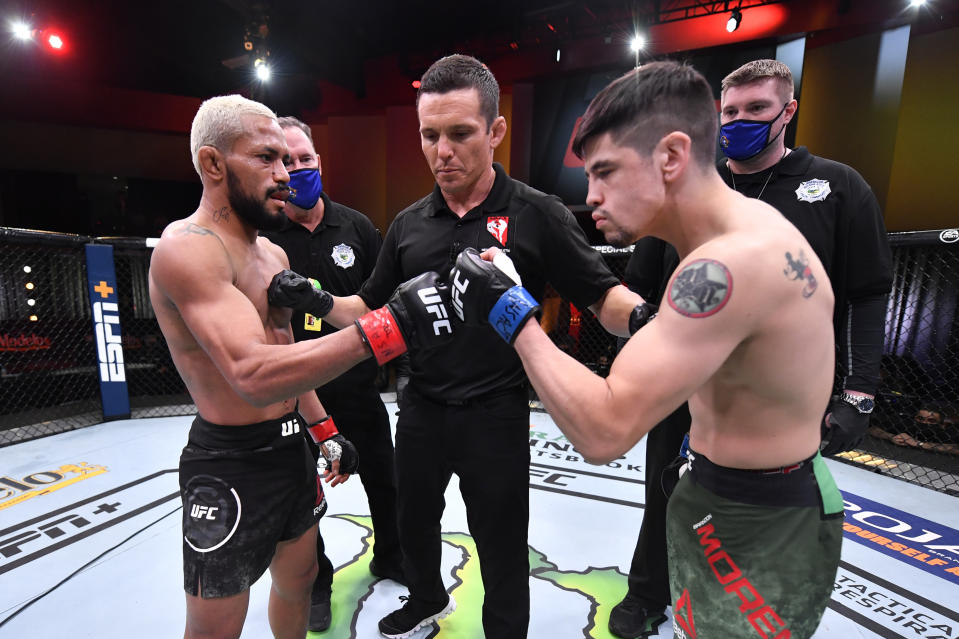 LAS VEGAS, NEVADA - DECEMBER 12:  (L-R) Deiveson Figueiredo of Brazil and Brandon Moreno of Mexico touch gloves prior to their flyweight championship bout during the UFC 256 event at UFC APEX on December 12, 2020 in Las Vegas, Nevada. (Photo by Jeff Bottari/Zuffa LLC)