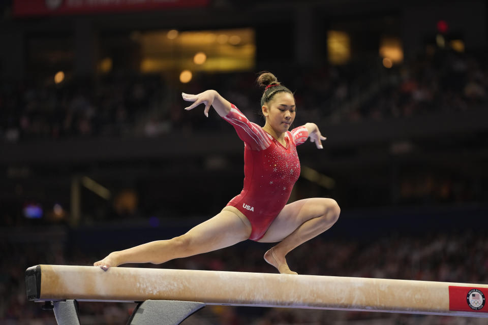 Sunisa Lee competes on the beam during the women's U.S. Olympic Gymnastics Trials Sunday, June 27, 2021, in St. Louis. For decades, high-profile college-bound Olympians were forced to make a choice: turn pro to cash in on their notoriety or remain an amateur to go to school. That's no longer an issue for athletes like gymnasts Sunisa Lee and Jordan Chiles after legislation cleared the way for them to profit off their Name, Image and Likeness. (AP Photo/Jeff Roberson)