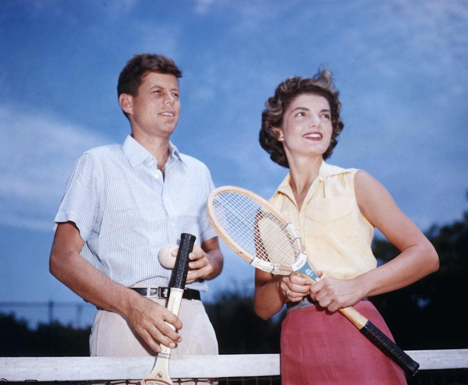 <p>Jackie and her fiancée, John F. Kennedy, play tennis at his family's home in Hyannis Port, MA. </p>