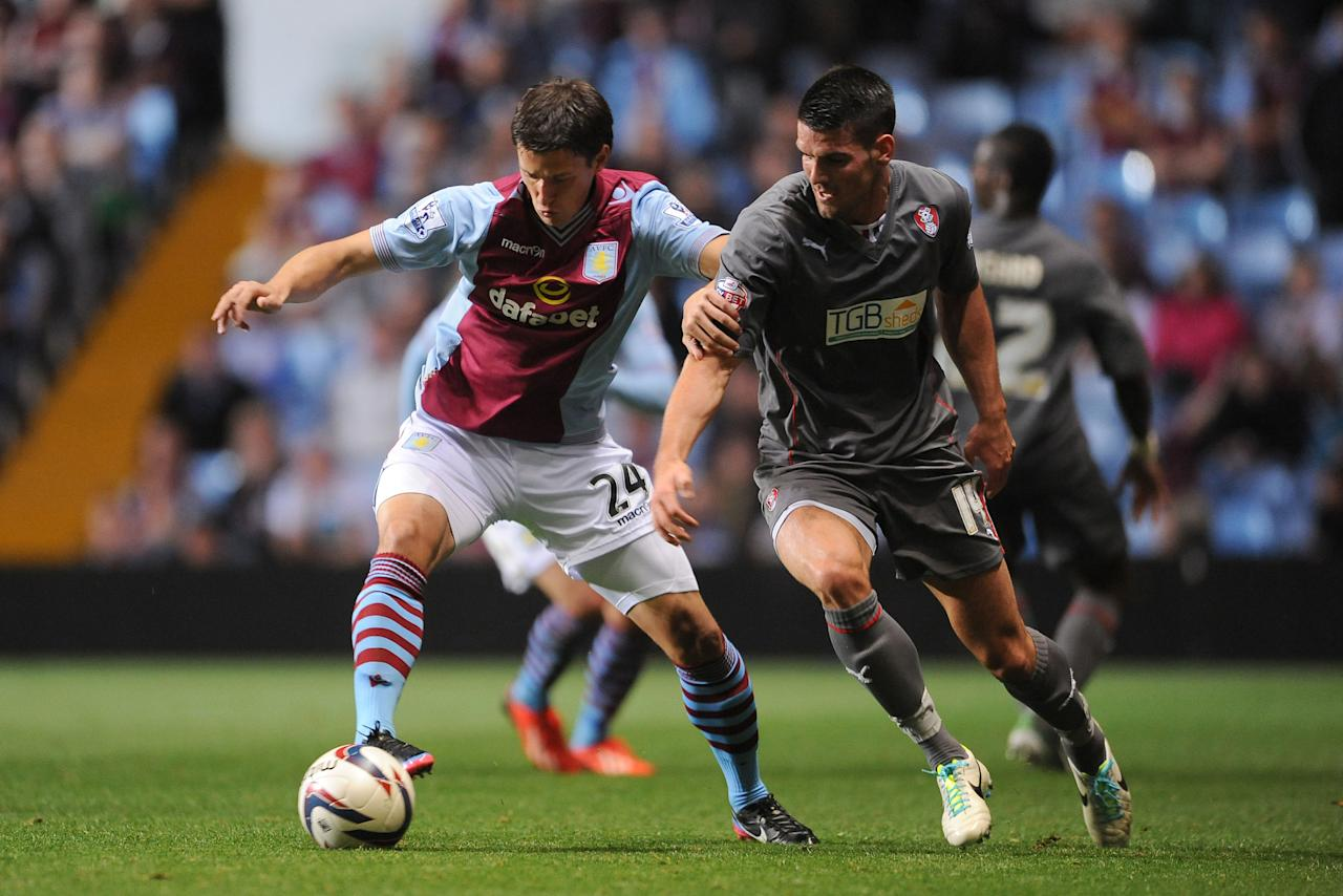 Aston Villa's Aleksandar Tonev (left) and Rotherham United's Mark Bradley (right) battle for the ball during the Capital One Cup, Second Round match at Villa Park, Birmingham.