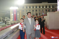 """In this photo provided by the North Korean government, North Korean leader Kim Jong Un walks with children during a celebration of the nation's 73rd anniversary at Kim Il Sung Square in Pyongyang, North Korea, early Thursday, Sept. 9, 2021. Independent journalists were not given access to cover the event depicted in this image distributed by the North Korean government. The content of this image is as provided and cannot be independently verified. Korean language watermark on image as provided by source reads: """"KCNA"""" which is the abbreviation for Korean Central News Agency. (Korean Central News Agency/Korea News Service via AP)"""