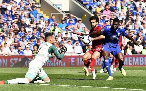 Mohamed Salah of Liverpool competes with Bruno Ecuele Manga of Cardiff City during the Premier League match between Cardiff City and Liverpool - Credit: GETTY IMAGES