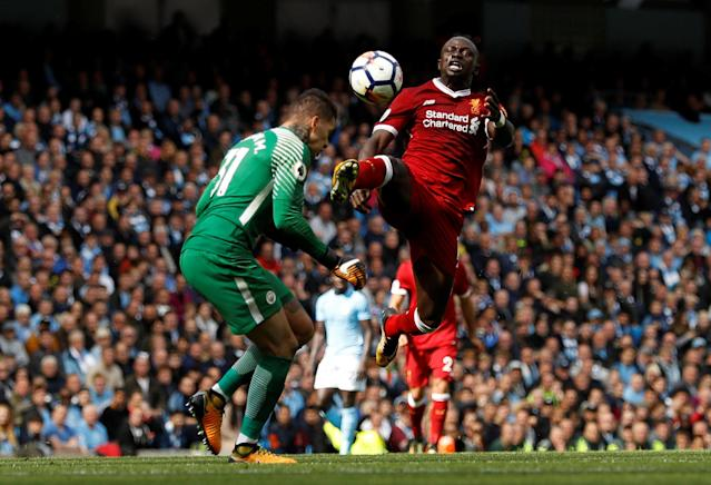 <p>Manchester City's Ederson Moraes is fouled by Liverpool's Sadio Mane resulting in a red card for Mane </p>