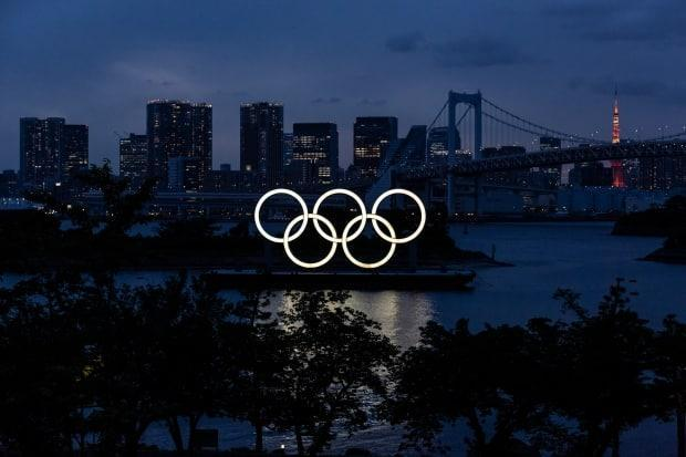 The Olympic rings are displayed by the Odaiba Marine Park Olympic venue in Tokyo. Tokyo 2020 president Seiko Hashimoto has stated she is 100 per cent certain that the Olympics will go ahead despite widespread public opposition in Japan.