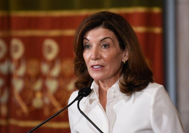 New York Gov. Kathy Hochul speaks to reporters after a swearing-in ceremony at the state Capitol on Tuesday in Albany, N.Y. On her first day in office, Hochul's administration quietly acknowledged almost 12,000 more COVID-19 deaths than were acknowledged by the previous government. (Hans Pennink/The Associated Press - image credit)