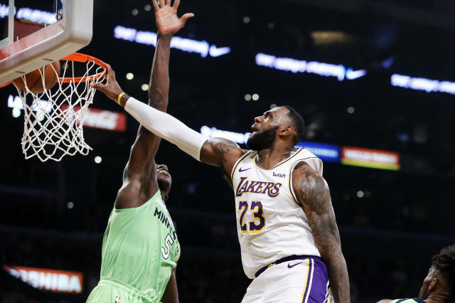 Los Angeles Lakers' LeBron James (23) dunks against Minnesota Timberwolves' Gorgui Dieng (5) during the first half of an NBA basketball game, Sunday, Dec. 8, 2019, in Los Angeles. (AP Photo/Ringo H.W. Chiu)