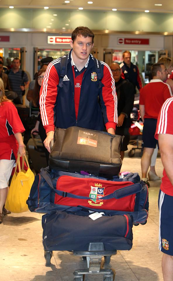 Dan Lydiate of the British and Irish Lions, arrives at Heathrow Airport, following their Test series triumph against Australia, just hours before the England cricket team pick up the baton.
