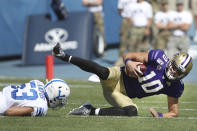 Washington quarterback Jacob Eason (10) is sacked by BYU linebacker Isaiah Kaufusi (53) in the first half of an NCAA college football game, Saturday, Sept. 21, 2019, in Provo, Utah. (AP Photo/George Frey)