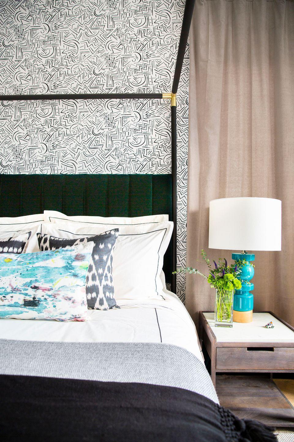 """<p>Though <a href=""""http://www.petilau.com/"""" rel=""""nofollow noopener"""" target=""""_blank"""" data-ylk=""""slk:Peti Lau"""" class=""""link rapid-noclick-resp"""">Peti Lau</a> designed this bedroom for a really cool grownup (<a href=""""https://www.housebeautiful.com/design-inspiration/house-tours/a30696949/peti-lau-chainsmokerss-drew-taggart-home/"""" rel=""""nofollow noopener"""" target=""""_blank"""" data-ylk=""""slk:The Chainsmokers's Drew Taggart"""" class=""""link rapid-noclick-resp"""">The Chainsmokers's Drew Taggart</a>) and not an actual teenager, the graphic wallpaper and pops of bright blue are perfect for a mature teen's room. Mixed with the more polished elements, like the four-post bed frame and deep green velvet headboard, it's the perfect balance of fun and seriousness. </p>"""