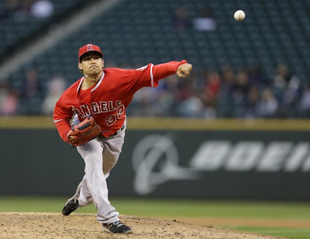 Los Angeles Angels starting pitcher C.J. Wilson throws in the fourth inning of a baseball game against the Seattle Mariners, Wednesday, May 28, 2014, in Seattle. (AP Photo/Ted S. Warren)