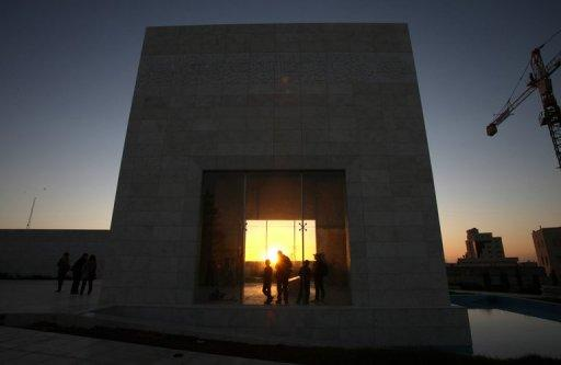 Palestinians gather to light candles at the mausoleum of Yasser Arafat in Ramallah, on November 10
