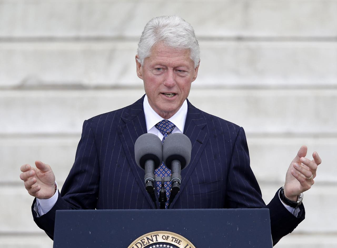 """Former President Bill Clinton speaks at the Let Freedom Ring ceremony at the Lincoln Memorial in Washington, Wednesday, Aug. 28, 2013, to commemorate the 50th anniversary of the 1963 March on Washington for Jobs and Freedom. It was 50 years ago today when Martin Luther King Jr. delivered his """"I Have a Dream"""" speech from the steps of the memorial. (AP Photo/Carolyn Kaster)"""