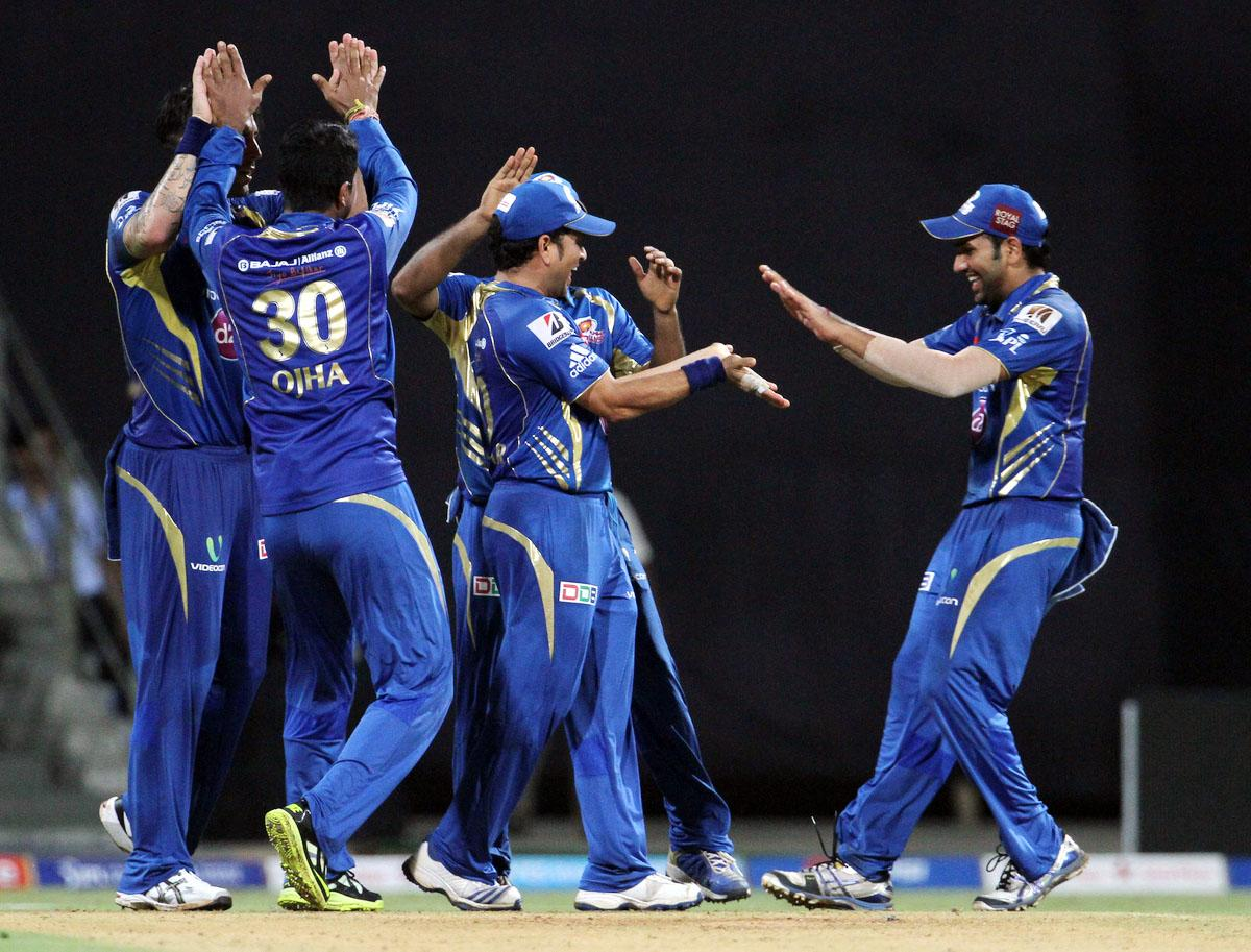 Mumbai Indian players celebrates after the wicket of Kings XI Punjab player David Miller during match 41 of the Pepsi Indian Premier League ( IPL) 2013 between The Mumbai Indians and the Kings XI Punjab held at the Wankhede Stadium in Mumbai on the 29th April 2013. (BCCI)