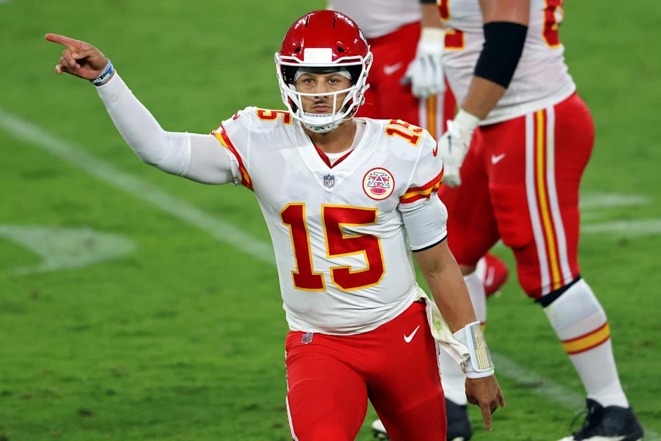 Patrick Mahomes motions during Monday's game.