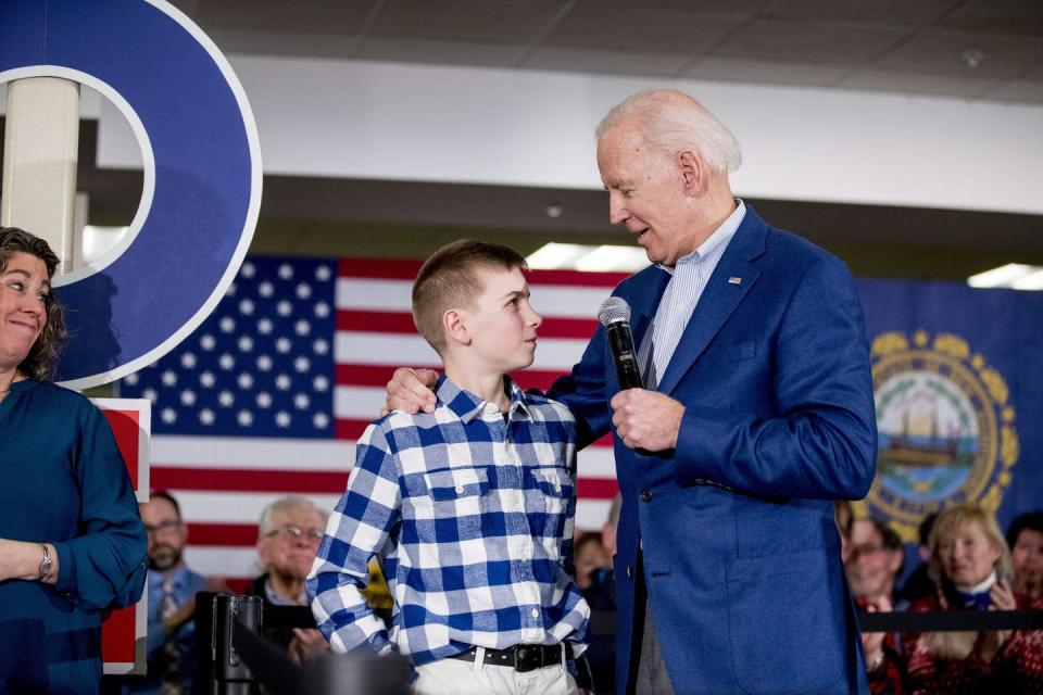 Joe Biden with a boy in a checked shirt.