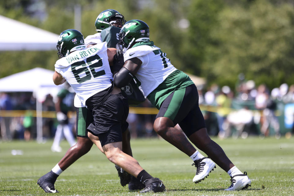 New York Jets offensive lineman Cameron Clark (72) attempts to block Greg Van Roten (62) and Morgan Moses (78) during practice at the team's NFL football training facility, Saturday, July. 31, 2021, in Florham Park, N.J. (AP Photo/Rich Schultz)