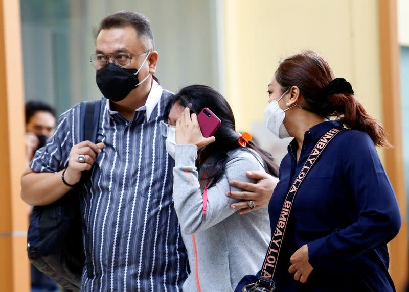 Family members of a passenger of Sriwijaya Air Flight SJ 182 react at a hospital after the plane crashed into the sea off the Jakarta coast, in Indonesia
