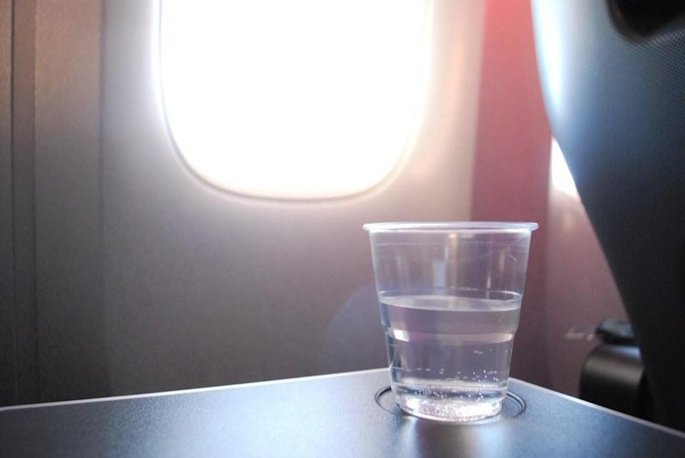 "You might want to shell out the extra cash for a ridiculously-overpriced bottle of water at the airport. A report from the <a href=""https://blogs.wsj.com/middleseat/2008/08/28/thinking-of-drinking-airplane-water-read-this/"" rel=""nofollow noopener"" target=""_blank"" data-ylk=""slk:Wall Street Journal"" class=""link rapid-noclick-resp""><em>Wall Street Journal</em></a> reveals that bacteria including salmonella and staphylococcus were found in airplane water, in addition to insect eggs. Another study conducted at the <a href=""https://www.ncbi.nlm.nih.gov/pmc/articles/PMC4661625/"" rel=""nofollow noopener"" target=""_blank"" data-ylk=""slk:University of Limerick"" class=""link rapid-noclick-resp"">University of Limerick</a> found 37 distinct bacterial species in airplane water, with long-haul flights having <a href=""https://bestlifeonline.com/countries-with-worst-tap-water/?utm_source=yahoo-news&utm_medium=feed&utm_campaign=yahoo-feed"" rel=""nofollow noopener"" target=""_blank"" data-ylk=""slk:worse water quality"" class=""link rapid-noclick-resp"">worse water quality</a> than their short-haul counterparts."