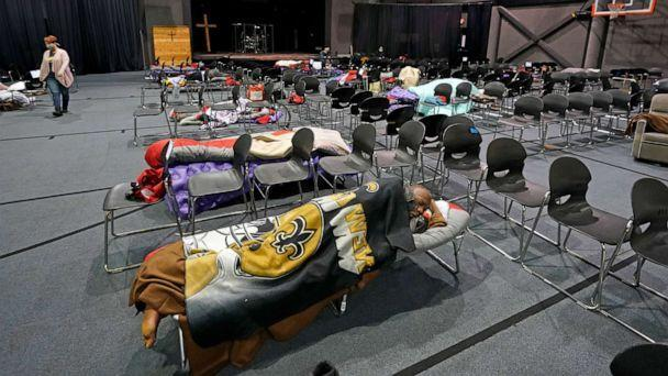 PHOTO: People seeking shelter from below freezing temperatures rest inside a church warming center Tuesday, Feb. 16, 2021, in Houston. (David J. Phillip/AP)
