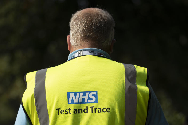 LONDON, ENGLAND - SEPTEMBER 15: A worker wearing an NHS Test and Trace tabard waits to deal with members of the public at a Covid Test site in South London on September 15, 2020 in Greater London England. The site saw a steady stream of drive in traffic, but only a small handful of walk-ins over the course of the first hour of opening. The Department Of Health has appealed to Britain's biomedical sector for 400 further laboratory technicians as the nation's return to school increases demand for Covid-19 tests. (Photo by Dan Kitwood/Getty Images)