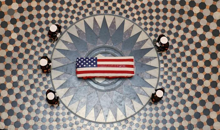 <p>DEC. 16, 2016 — Former astronaut and U.S. Sen. John Glenn lies in state under a Marine honor guard in the rotunda of the Ohio statehouse in Columbus. (Bill Ingalls/NASA handout via Reuters) </p>