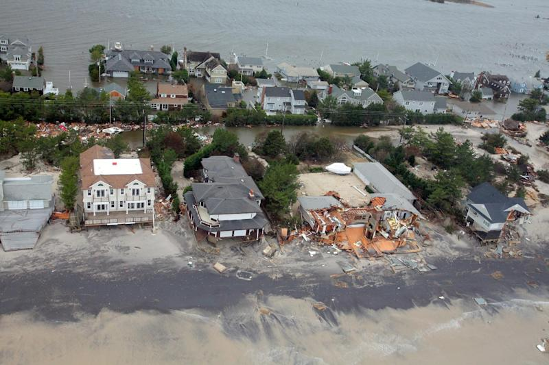FILE - This Oct. 30, 2012 file photo provided by the U.S.Air Force shows an aerial view of damage to the New Jersey shoreline following Superstorm Sandy. There are a rising number of homes damaged by Sandy hitting the market - ranging from 10 percent off pre-storm prices for upscale homes in New York's Long Island and the Jersey Shore to up to 60 percent off modest bungalows in Staten Island and Queens - but it's very much a game of buyer beware. (AP Photo/U.S. Air Force, Master Sgt. Mark C. Olsen, File)