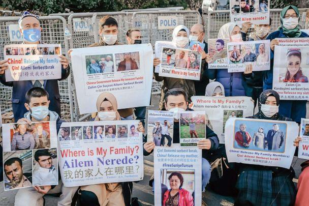 PHOTO: Members of the Muslim Uighur minority hold placards as they demonstrate in front of the Chinese consulate on December 30, 2020, in Istanbul. (Bulent Kilic/AFP via Getty Images)