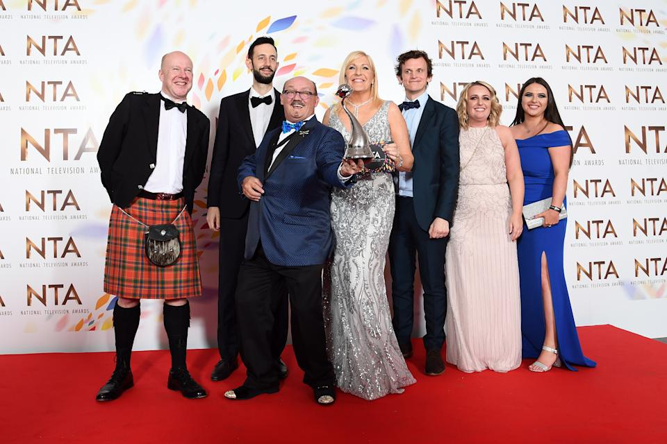 "Brendan O'Carroll, BBC Head of Comedy Josh Cole, Jennifer Gibney and cast members, accepting the Comedy award for ""Mrs Brown's Boys"", pose in the winners room  during the National Television Awards 2020 at The O2 Arena on January 28, 2020 in London, England. (Photo by Gareth Cattermole/Getty Images)"