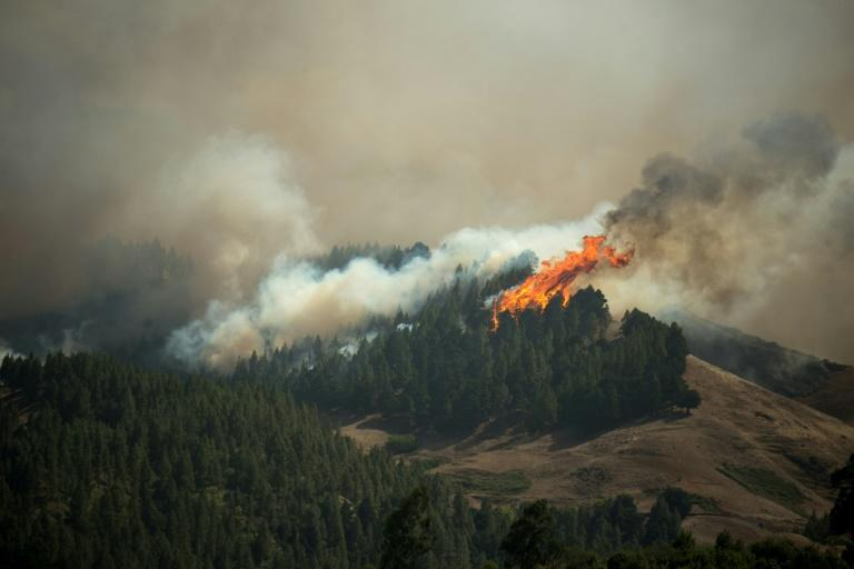 The blaze, the third in 10 days in the mountainous centre of the island, has forced the evacuation of several villages with a combined population of 9,000