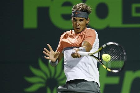 Mar 25, 2014; Miami, FL, USA; Rafael Nadal hits a forehand against Fabio Fognini (not pictured) on day nine of the Sony Open at Crandon Tennis Center. Geoff Burke-USA TODAY Sports