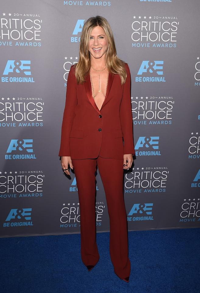 <p>A rouge Gucci tuxedo was all Jennifer needed to wow. The body chains didn't hurt either. <i>[Photo: Getty]</i> </p>