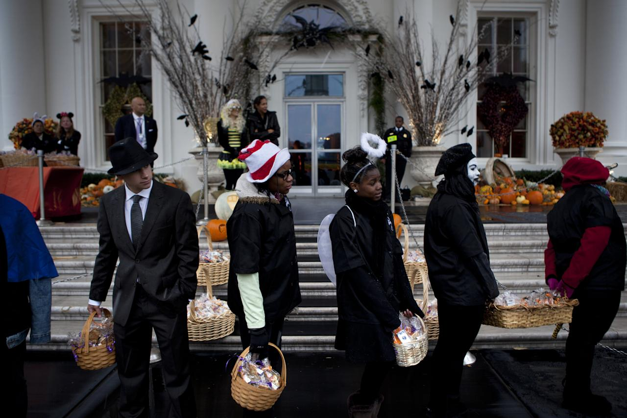WASHINGTON - OCTOBER 29:  Actors, staff and volunteers wait to greet trick or treaters at the White House October 29, 2011 in Washington, DC.  President Barack Obama and first lady Michelle Obama hosted military families and other trick or treaters for a Halloween party.  (Photo by Brendan Smialowski/Getty Images)