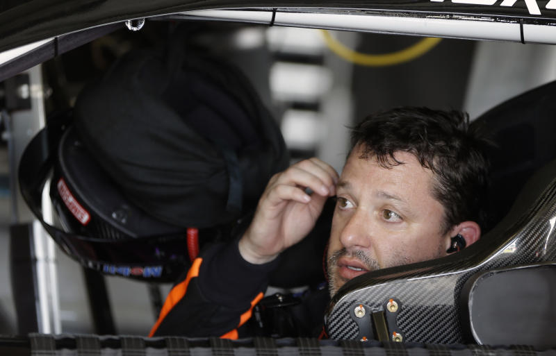 Tony Stewart waits in his car in his garage before going out on the track during a practice session for the NASCAR Daytona 500 Sprint Cup Series auto race at Daytona International Speedway, Friday, Feb. 22, 2013, in Daytona Beach, Fla. (AP Photo/John Raoux)