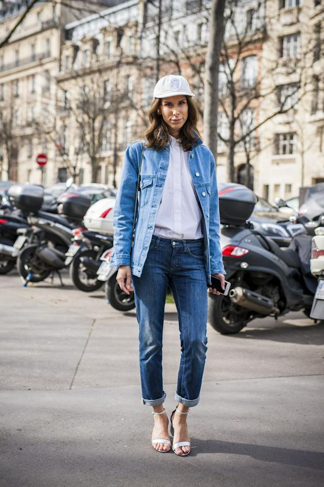"""<p>Don't listen to nay sayers. Denim on denim is a DO! The denim doesn't have to match necessarily,  it's really more about proportions and keeping it simple with your accessories. The touch of a <a href=""""https://www.amazon.com/slp/womens-white-button-up-shirt/oqj7c262v47c5ft?tag=syn-yahoo-20&ascsubtag=%5Bartid%7C10055.g.27890498%5Bsrc%7Cyahoo-us"""" target=""""_blank"""">crisp white button down</a>, baseball cap, and ankle strap heel keep things sophisticated and polished. </p>"""