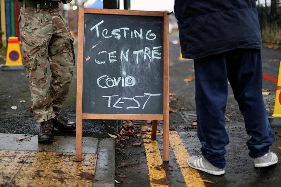 A blackboard is pictured at the entrance of a coronavirus disease (COVID-19) testing centre in Liverpool, Britain November 11, 2020. REUTERS/Carl Recine