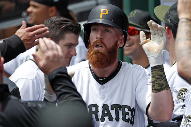 Pittsburgh Pirates' Colin Moran, center, celebrates in the dugout after hitting a two-run home run off Atlanta Braves starting pitcher Mike Foltynewicz in the second inning of the team's baseball game in Pittsburgh, Thursday, June 6, 2019. (AP Photo/Gene J. Puskar)