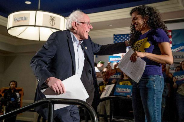 PHOTO: Democratic presidential candidate Sen. Bernie Sanders is welcomed to the stage by Sunrise Movement co-founder Varshini Prakash, right, at the Graduate Hotel, Jan. 12, 2020, in Iowa City, Iowa. (Andrew Harnik/AP)