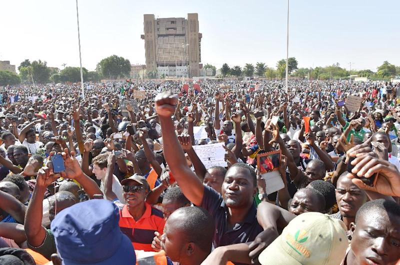 People protest at the Place de la Nation in Burkina Faso's capital Ouagadougou, on November 2, 2014, calling for the departure of the military