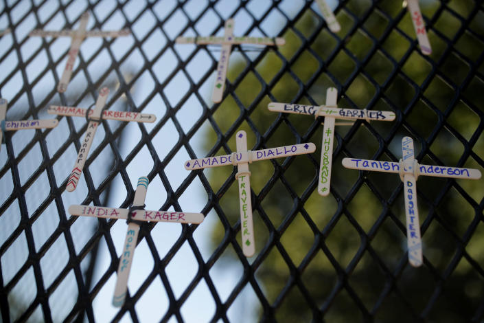 Image: Crosses on White House fence (Maya Alleruzzo / AP)